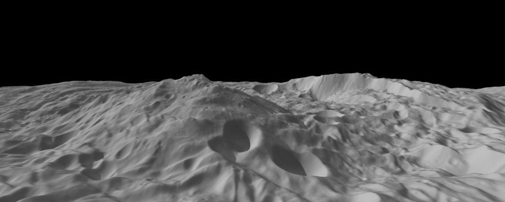Aufregende Landschaften am Südpol von Vesta: Diese aus einem digitalen Geländemodell berechnete Ansicht des Asteroiden Vesta zeigt einen Schrägblick auf die von Einschlägen zerklüftete Südpolarregion. Das Bild hat eine Auflösung von etwa 300 Metern pro Pixel und der vertikale Maßstab ist um das 1,5-fache gegenüber dem horizontalen Maßstab überhöht. Der Berg in der Bildmitte ragt etwa 20 Kilometer aus dem Rheasilvia-Becken heraus.